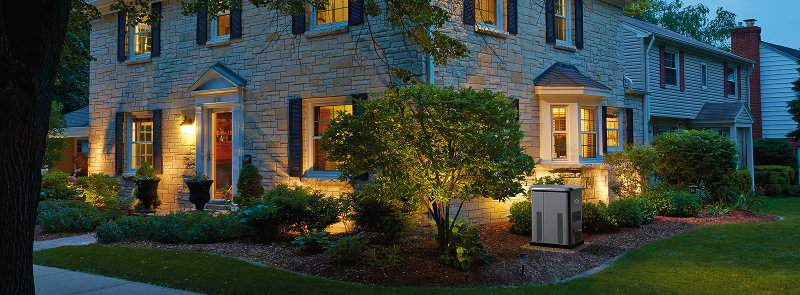 A 12-Kilowatt Briggs and Stratton Home Standby Generator Installed Outside a Mid-Sized Two Story Home