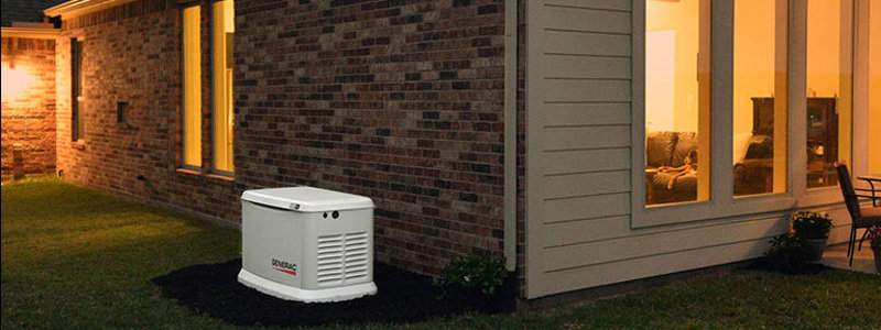 Generac Guardian Home Standby Generator installed next to a home.