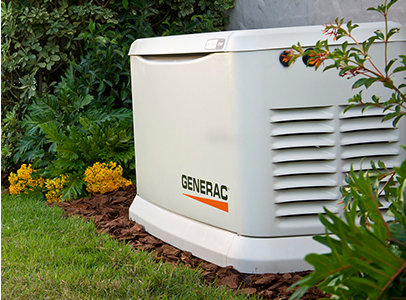 Generac Guardian Home Standby Generator with Landscaping bushes and flowers.