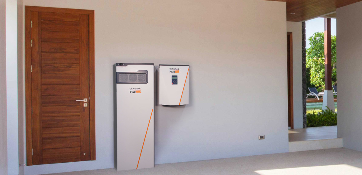 A Generac PWRcell Battery Cabinet and PWRcell Inverter Installed in a Garage